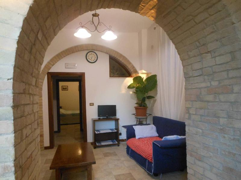The living room from the dining-kitchen arch