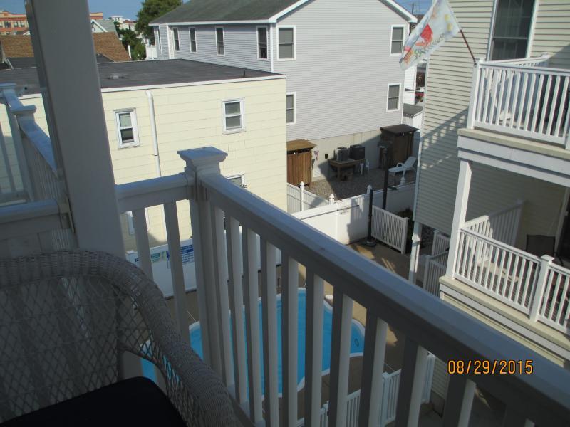 Deck overlooking pool.