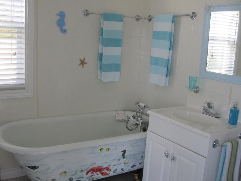 Colourful bathroom with claw foot tub and separate shower