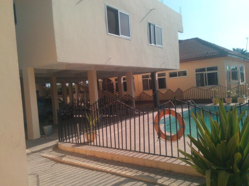 Accra serviced villas. One bedroom apartment villa. Self-contained villa. Back view from pool side