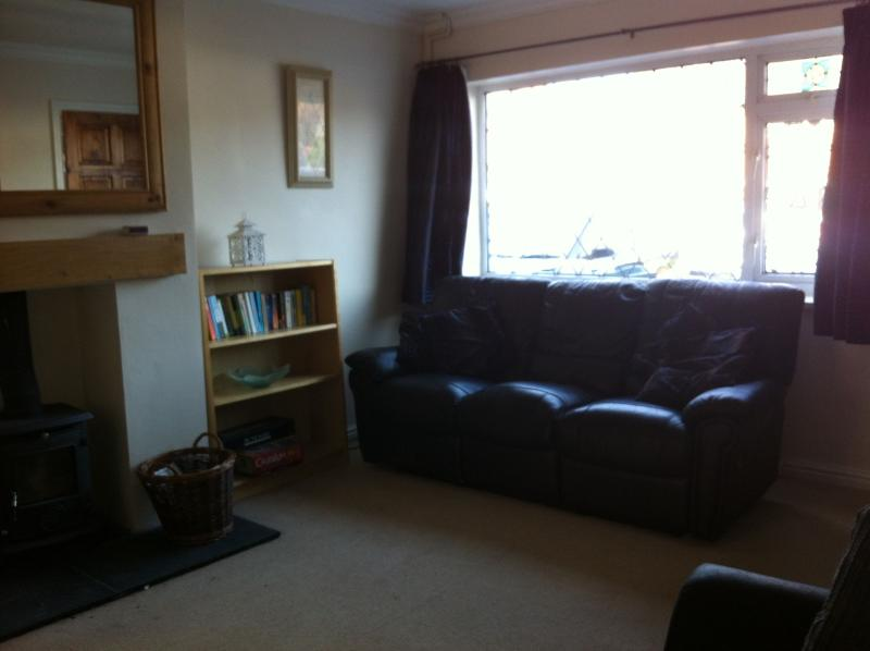 The living room, with a second sofa and a log burner.