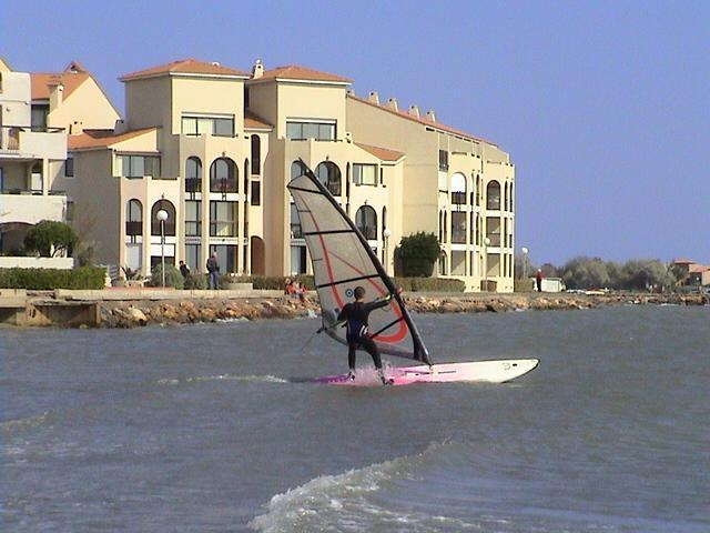 windsurfer moving outside the apartment