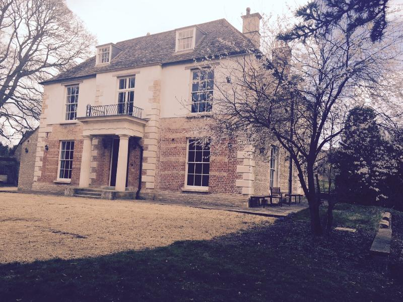 Front view of Cedar House with lots of private parking