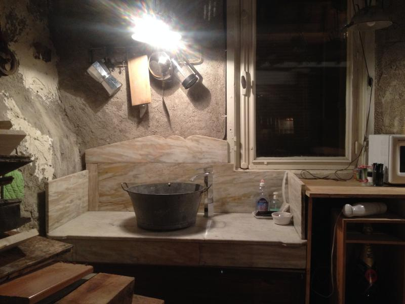The quirky galvanised kitchen sink and marble top