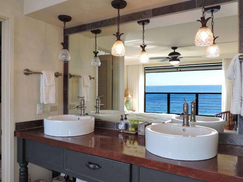 Designer copper top vanities with twin vessel sinks and bamboo faucets