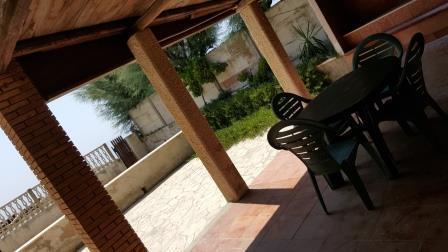garden terrace and veranda at sea level