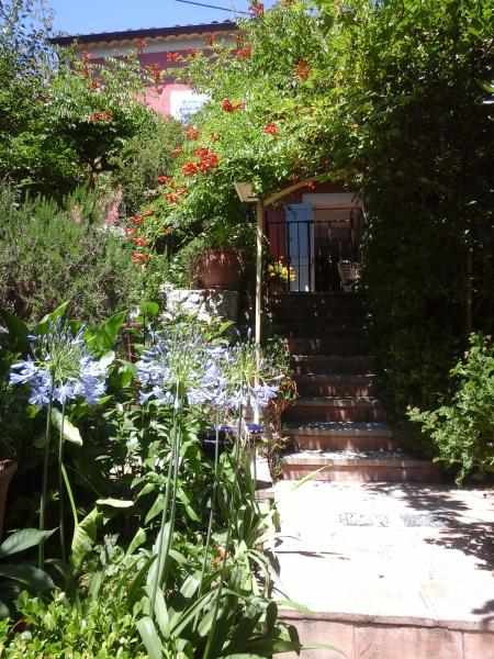 the stairs leading to the garden and private terraces and bbcue