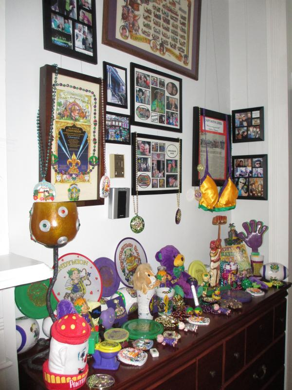 Mardi Gras Endymion parade rolls in front of the house ~ our wall of memorabilia in the hallway