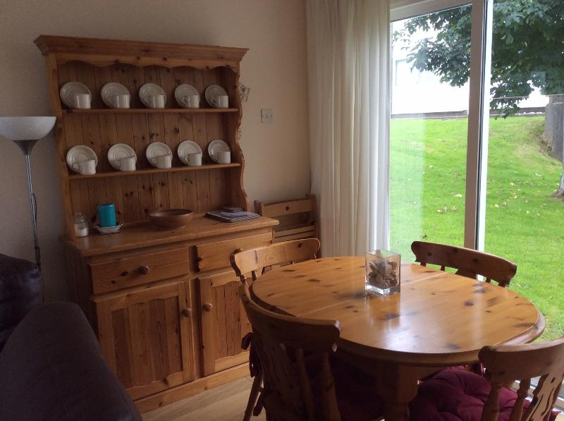 Dining area with patio doors leading to extensive shared lawn