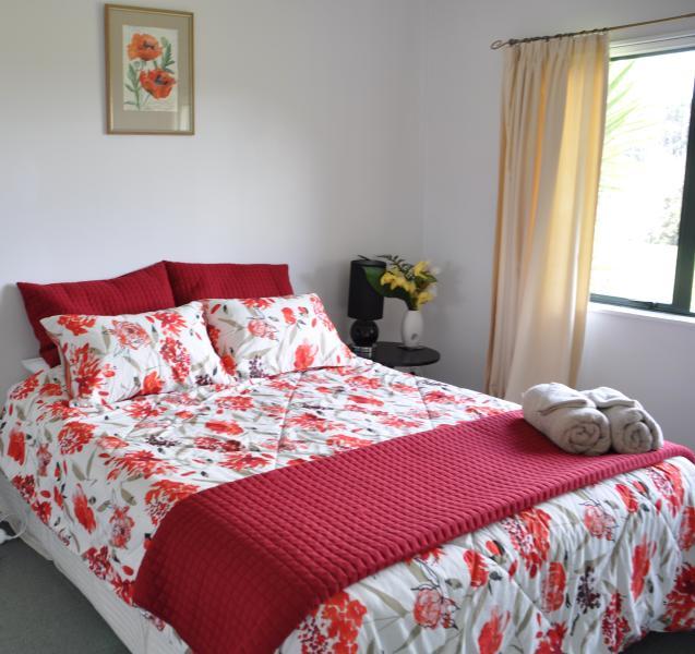 Queen bedroom with shared bathroom.