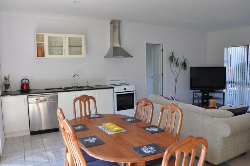 Informal dining/lounge/kitchen/t.v. area