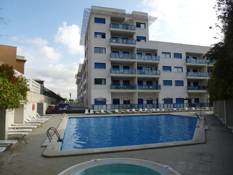 Hotel swimming pool and apartment block facade