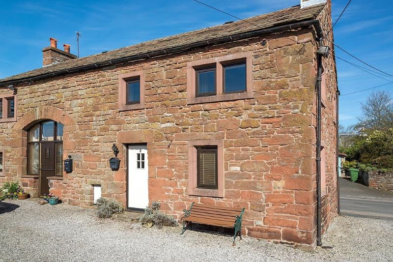 2 Yew Tree Cottages entrance at rear of building with off road parking