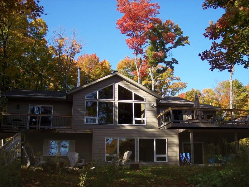 Cottage has firepit and huge sundeck with barbecue
