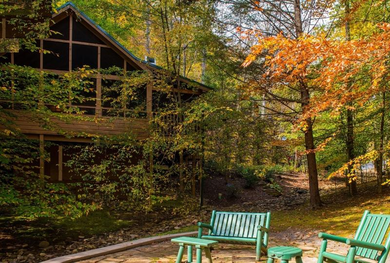 Brilliantly colored leaves grace the cabin in autumn.
