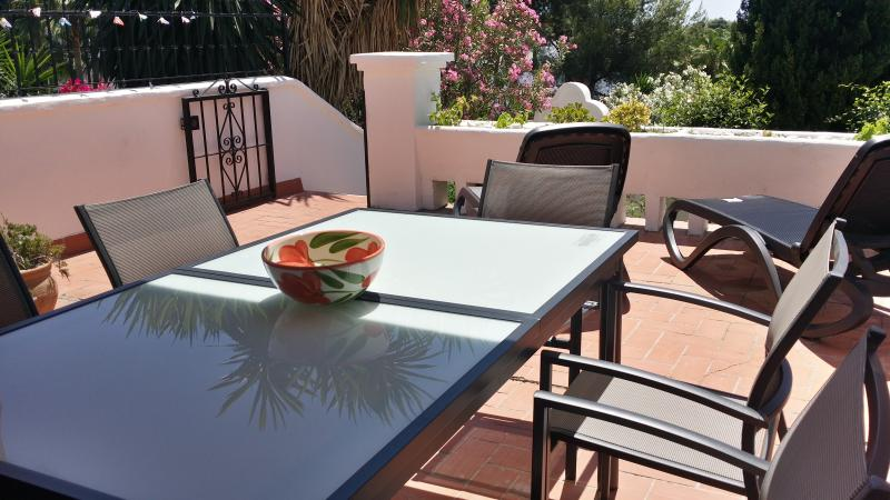 Terrace with sun loungers and extendable table for al fresco dining with friends!
