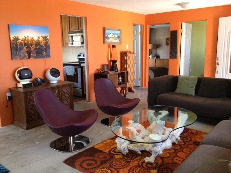 Living room with doors to kitchen, bathroom, bedrooms.