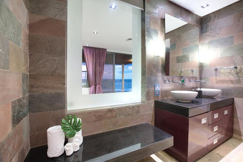 En-suite Bathroom 3 with his & her basins and rain shower feature