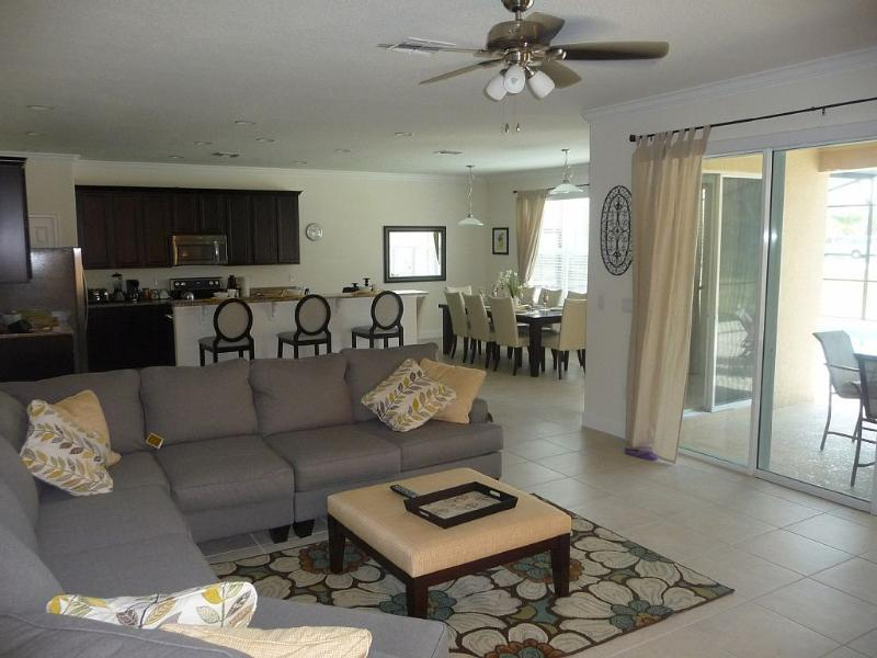 An open plan lounge dining and kitchen area.