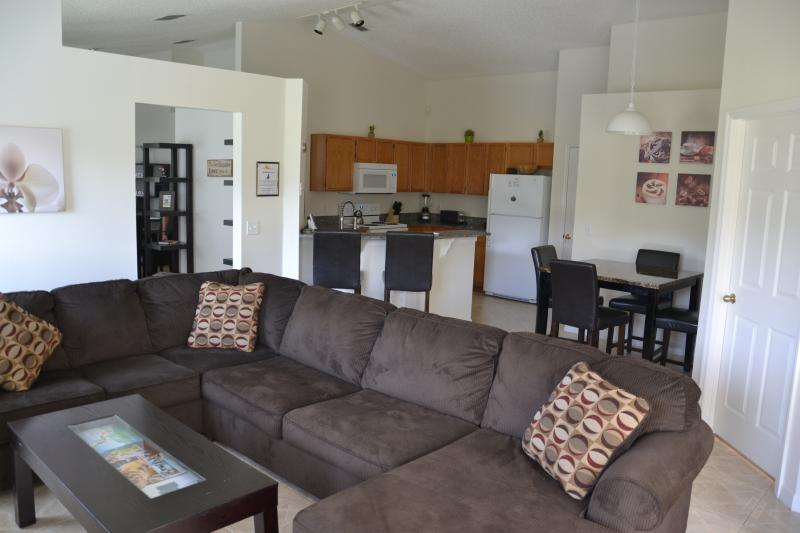 Family room with large couch and flatscreen