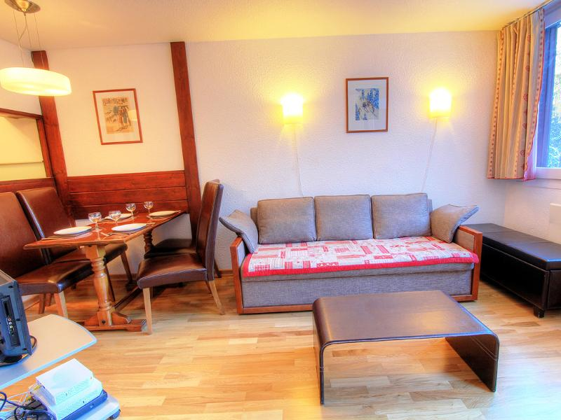 The comfortable living area has a dining table, sofa and flat screen TV and DVD player