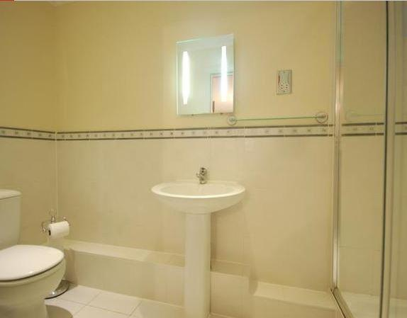 En suite shower room with cubicle, basin, toilet, shaver point, towels are provided free of charge