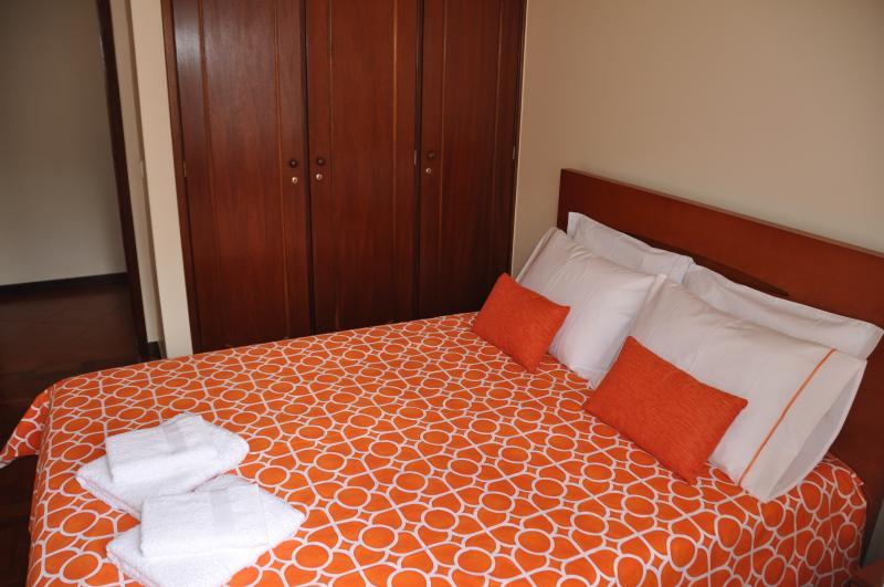 A second bedroom: queen bed, built-in wardrobe..