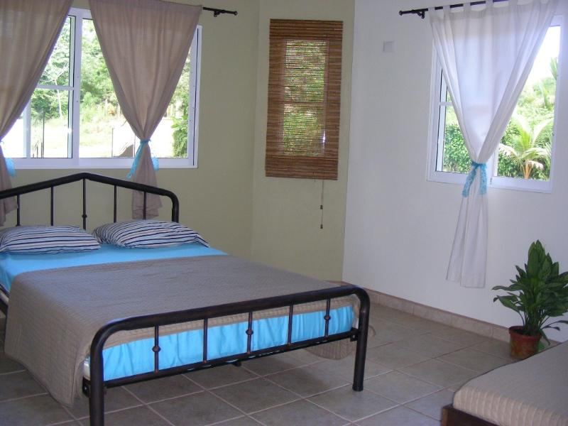 Bedroom 1 with a double bed and a small bed for child
