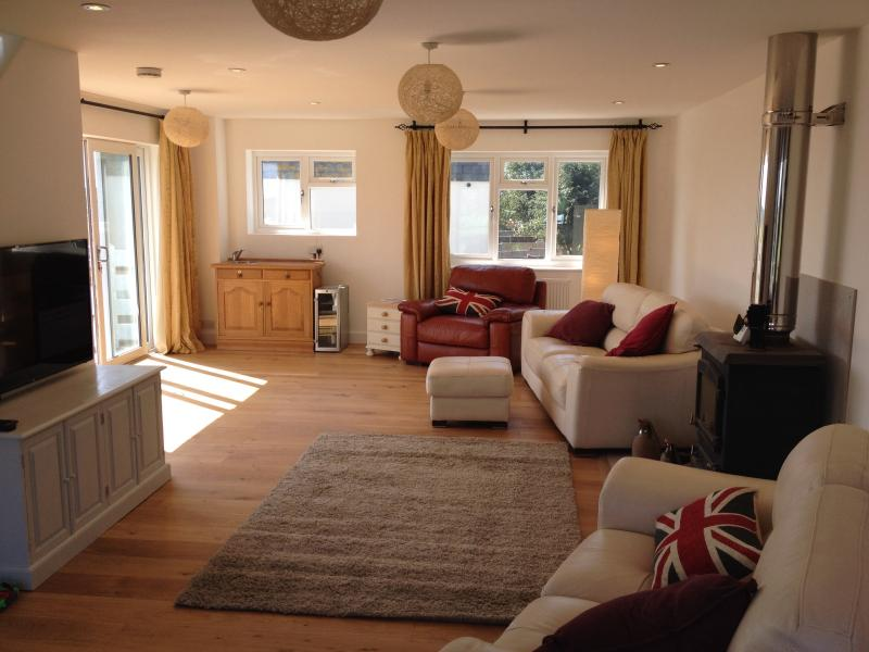 The spacious first floor sitting room leading onto the roof terrace with panoramic sea views.