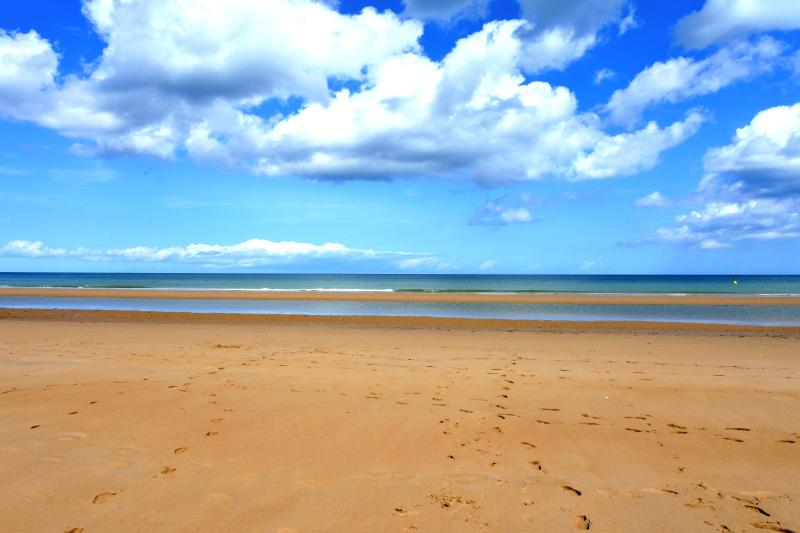 Stunning and dramatic Omaha Beach in the Summer sun. The hardest fought beach of the D-Day Landings.