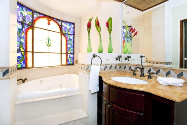 Jacuzzi tub in each condo