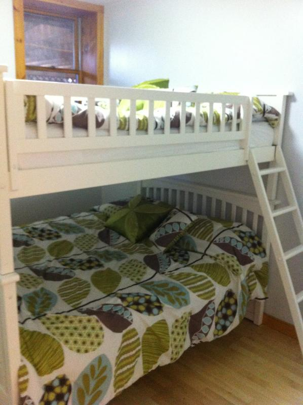 Bed room with one queen bunk bed