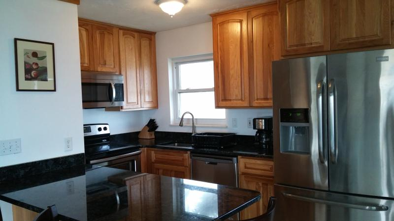 Completely remodeled kitchen with brand new cabinets, stainless steel appliances, granite countertop