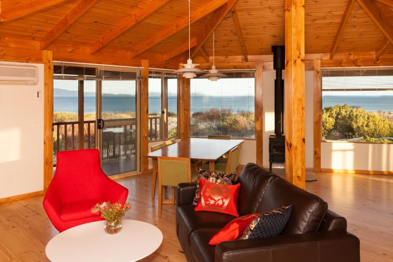 Peace & Plenty living room with panoramic views over Great Oyster Bay
