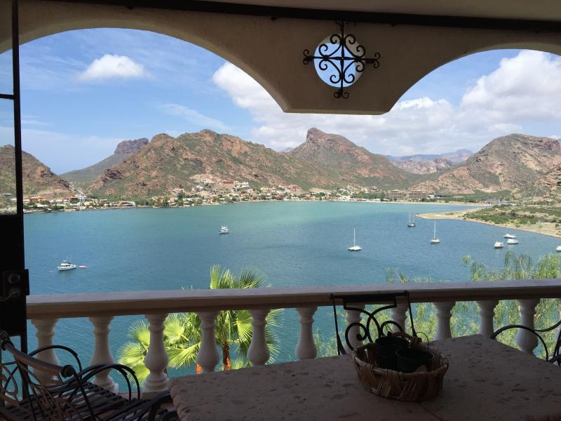View out the living room and sun room to the Bahia and the mountains beyond.
