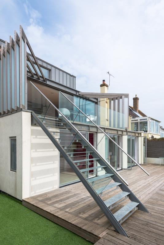 Beachside rear of house stairs to lounge