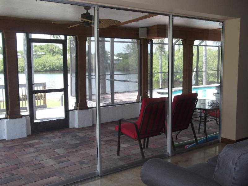 A look at the Lanai from the den, through the triple slider ( fully opens )