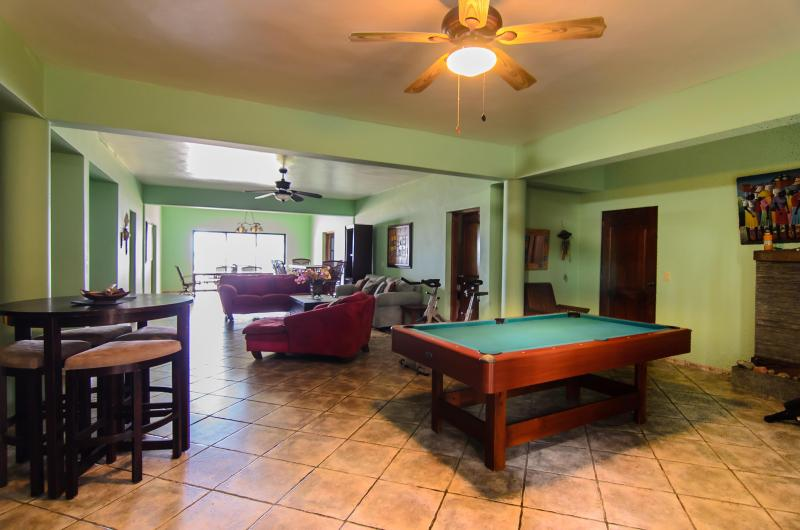 Family room with Pool table, and weight machines