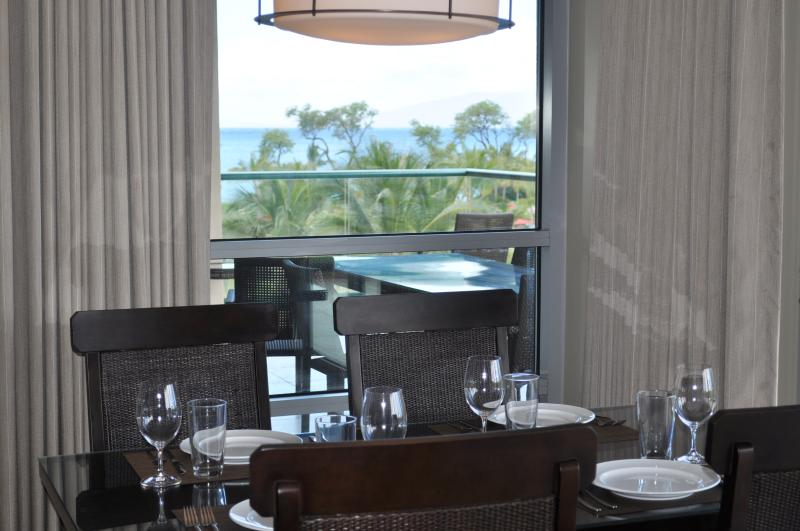 Inside dining with view to ocean -- notice there's also outside dining for six on lanai