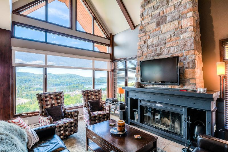 Living room with stunning views and fireplace