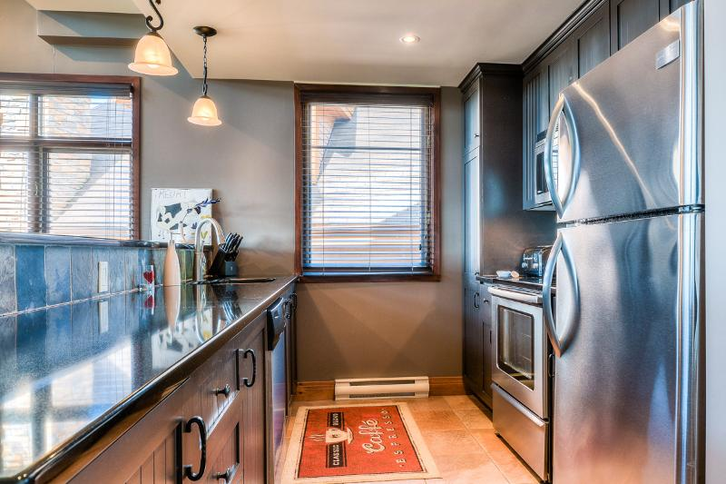 Fully-equipped kitchen with heated floor