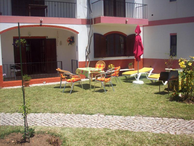 Frente del apartamento en planta baja con terraza
