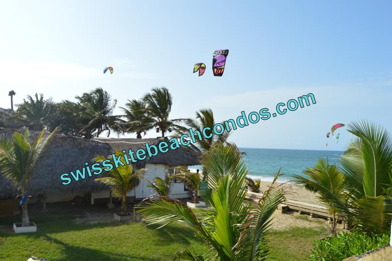 View from the front facing balcony, lounge on our comfy deck chairs and sofas and watch the kiting