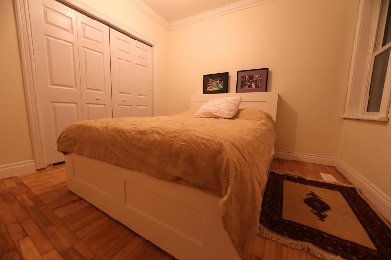 Master bedroom: queen size bed with storage underneath