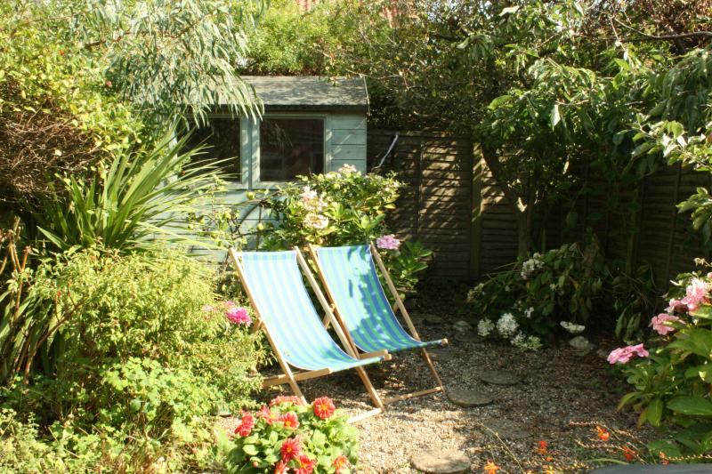 Private sun-filled garden with outdoor dining, BBQ and secure shed to store outdoor equipment