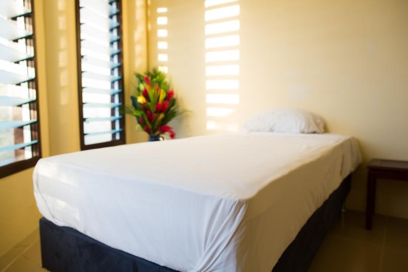 Single bedrooms are clean and calm.
