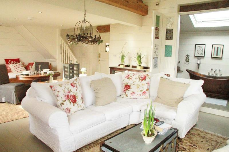 large squashy feather sofa, real fire, huge roll top copper bath, mezzanine bedrom