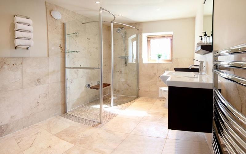 The luxury wet room is en suite to the bedroom