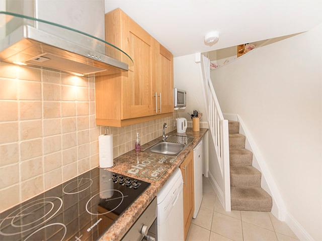 Galley kitchen leads to living accommodation on the first floor