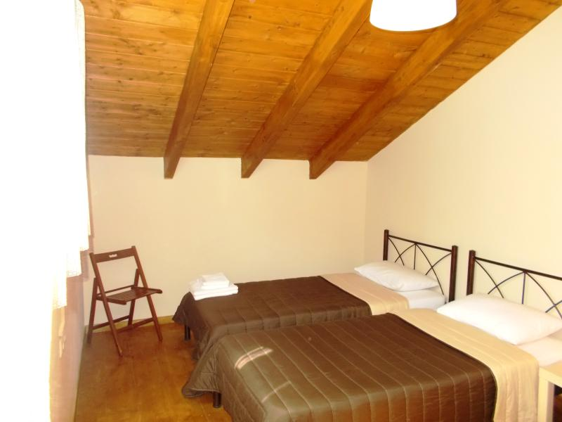 Bedroom with two single beds in the attic